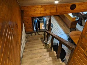 Photo of the stairs leading down to the tasting room from the second floor