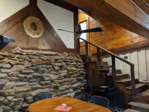 The fieldstone and timber main wall in the tasting room