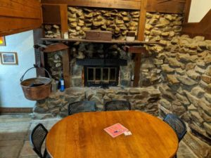 The stone fireplace in the tasting room